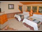 2nd floor bedroom.  2 double beds and full bathroom.