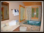 Bath to 2nd floor bedroom.  Jacuzzi tub and walk in shower.