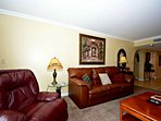 Living area features comfortable seating for the whole family!