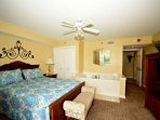 Master Bedroom features queen bed, flatscreen tv, balcony access, and jetted tub!