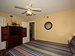 Guest Bedroom features plush queen bed and flat-screen TV.