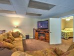 Relax on the living room's plush sofa while watching the flat-screen cable TV.