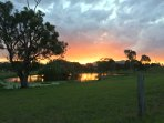 Glorious summer sunset over lower dam on our property