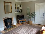 Sitting room with wood burner and smart tv