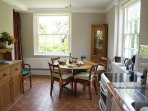 Dining room and galley kitchen overlooking garden