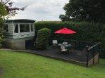 Plas Llwyd caravan set in private mature garden  with decking & garden furniture & A gas BBQ.