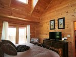 Natural wood paneling in the master bedroom at Beech View Lodge.
