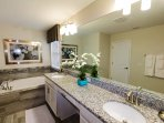 Ample Master enSuite Bathroom with tub and 2 sinks for everyone's convenience