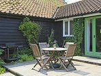 Terrace with garden furniture and BBQ