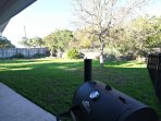 Fenced Back Yard with Charcoal Grill