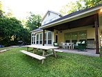 Back Porch - Barbecue & relax in style with the beautiful lake and green lawn in full view!
