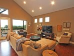 Relaxed Living Space with Lake View and HDTV