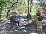 Shaded Outdoor Seating with Gas Grill - Propane is Provided for Guests