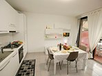 Bright kitchen-diner with access to the terrace