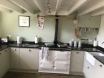 fully fitted kitchen with fridge freezer oil AGA and a microwave / oven combination for convenience.