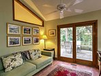 Cozy up on the couch and read a book in the sunroom.