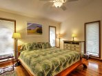 This bedroom offers a king-sized bed.