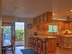 The kitchen is spacious and fully equipped with everything you'll need to prepare tasty meals.