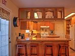 Pull up a stool to the kitchen bar to keep the chef of the group company as they prepare a meal.
