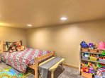 Equipped with a twin-sized bed and a plethora of toys, this second bedroom is perfect for kids!
