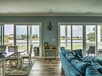 2 sets of sliding glass doors offer gorgeous views of the water inlet and flood the space with natural light.