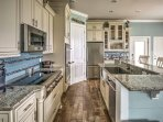 The gourmet kitchen is truly a chef's dream, fully equipped with 3 ovens, a 6-burner cooktop, 3-person island bar and a...