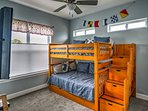 The bunk room has a full-over-full bunk bed with full trundle.