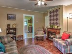 The cozy living room features plush furnishings, a gas fireplace and flat-screen TV.