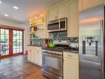 The fully equipped kitchen has state -of-the-art stainless steel appliances.