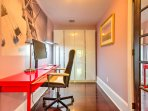 Catch up on work at the office area with free wifi and a comfortable swivel chair.