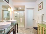 The downstairs bathroom offers an oversized walk-in shower and tile floors.