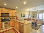 Stainless steel appliances and ample counter space make meal prep a breeze in this kitchen.