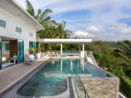 Infinity pool with lush tropical landscape views.