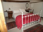 King size double bed in the second bedroom.