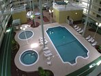 indoor facility including heated pool, spa, kiddie pool and exercise equipment.