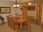 Entry with bench, storage and large dining or game table for 8 to 10