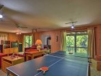 The home features a game room with ping pong, air hockey, and poker.