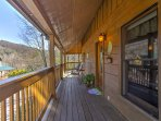 Admire gorgeous mountain views from the 3-sided wraparound porch with screened-in back porch!