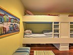 This bedroom has 2 twin-over-twin bunk beds, perfect for kids!