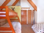 The dormer/bunk room has two twin beds plus a twin over full bunkbed