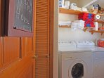 Separate laundry room with a washer and dryer off of the kitchen