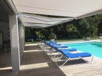 The pool  house with 3 separate awnings for your comfort