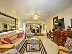 The living room comes equipped with all your basic comforts, including plush furnishings and a flat-screen cable TV.