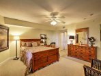 Lay back on the queen-sized bed in the second bedroom while a film plays on the flat-screen cable TV.