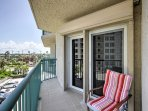 Listen to the soothing sounds of the ocean from the balcony with outdoor chairs for added comfort.