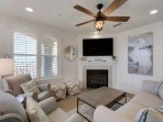 Living room features plenty of Plush Furnishings, as well as a Fireplace, Flat Screen TV, and views of the Gulf of...