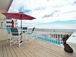 Beach facing deck with 4 top dining set. Amazing ocean views where you can enjoy meals, drinks and even dolphin...