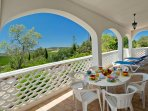 Covered terrace for al fresco dining and relaxing