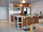 Well Equipped Kitchen with Stainless Steel Appliances, Dishwasher and Granite Counter Tops.