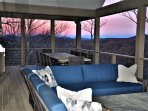 Gorgeous Sunset on Main Floor Deck with L-Shape Sectional and 10-seat Tin Table